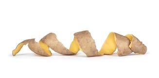 La pelle proviene dalle patate a spirale fotografie stock