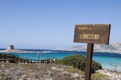 La Pelosa beach on a cloudy day Sardinia. Summer 2016 La Pelosa beach on a cloudy day Sardinia Royalty Free Stock Image