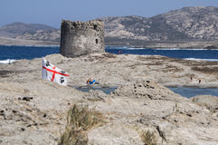 La Pelosa beach on a cloudy day Sardinia. Summer 2016 La Pelosa beach on a cloudy day Sardinia Royalty Free Stock Photography