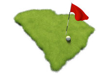 La pelota de golf y la asta de bandera en putting green del curso formaron como el estado de Carolina del Sur Fotos de archivo