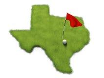 La pelota de golf y la asta de bandera en putting green del curso formaron como el estado de Tejas Imagen de archivo