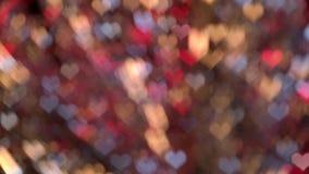 La pendenza rossa, gialla e blu ha offuscato il fondo del cuore del bokeh a forma di video d archivio