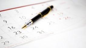 La penna sul calendario Immagini Stock