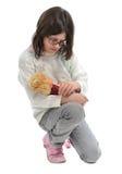 Muchacha con la muñeca Fotografía de archivo libre de regalías