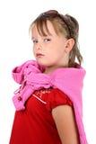 La pequeña muchacha orgullosa que miraba la cámara aisló blanco Fotos de archivo libres de regalías