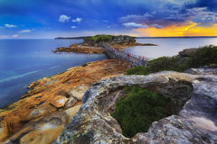 La Perouse Bridge from Top Sunset. Colourful sunset over Citadel on Bare Island in Sydney`s Botany Bay coastal area. Stormy weather and rugged terrain reflect Royalty Free Stock Photos