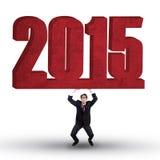 La persona asiatica tiene il numero 2015 Immagine Stock Libera da Diritti