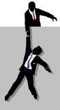 La persona di affari dà la mano amica dell'operaio in su Immagini Stock Libere da Diritti
