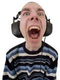 La persona nel gridare dei trasduttori auricolari Fotografia Stock