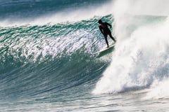 La persona que practica surf regocijó la bahía estupenda de Jeffreys de los tubos foto de archivo