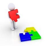 La persona si accinge a completo il puzzle Fotografia Stock
