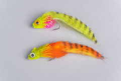La pesca con la mosca variopinta due vola su Gray Background Fotografia Stock