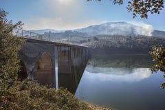 La Pesga bridge over Gabriel y Galan Reservoir waters, Spain Royalty Free Stock Image