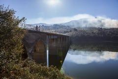 La Pesga bridge over Gabriel y Galan Reservoir waters, Spain Stock Photography