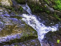 La Petite Cascade - The Little Waterfall of the Cance and Cancon rivers  - Normandy, France. La Petite Cascade - The Little Waterfall of the Cance and Cancon royalty free stock image