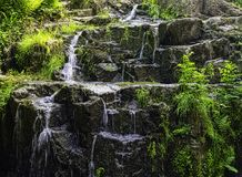 La Petite Cascade - The Little Waterfall of the Cance and Cancon rivers  - Normandy, France. La Petite Cascade - The Little Waterfall of the Cance and Cancon royalty free stock images