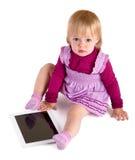 La petite fille avec la table Photos stock