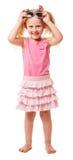 La petite fille blonde mignonne utilise des lunettes de soleil d'isolement sur le blanc photo libre de droits