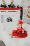 La petite fille célèbre Noël photographie stock