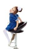 La petite fille dans la robe bleue Photo stock