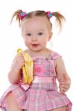 La petite fille mange la banane Images libres de droits