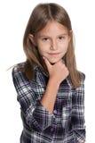 La petite fille pense Photographie stock libre de droits