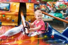 La petite fille sur le carrousel Images stock