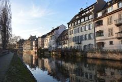 La Petite France with reflections. Petite France is a historic quarter of Strasbourg. It is located at the western end of the Grande ÃŽle, which contains the stock photography