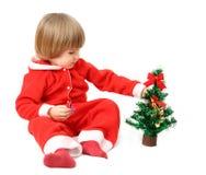 La petite Santa avec un fourrure-arbre Photographie stock