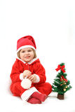 La petite Santa avec un fourrure-arbre Images stock
