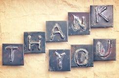 La phase VOUS REMERCIENT a fait à partir des lettres en métal Image libre de droits