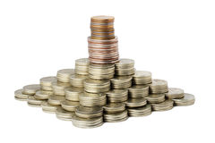 la pièce de monnaie financière effectuent la pyramide Photos libres de droits