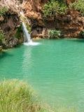La piccola cascata in Pego fa l'inferno Fotografie Stock Libere da Diritti