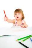 La piccola neonata estrae la matita Immagine Stock