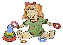 La piccola neonata sta giocando con un giocattolo Fotografia Stock