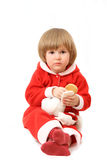 La piccola Santa con un giocattolo Fotografie Stock Libere da Diritti