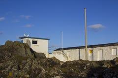 La piedra antigua construyó la casa barco usada por los funcionarios reales de la raza del club náutico de Ulster para supervisar foto de archivo libre de regalías