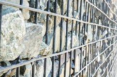 La piedra es una vieja malla oxidada del hierro Imagen de archivo libre de regalías