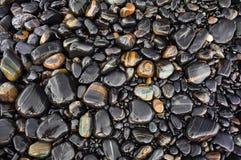 La piedra negra mojada Fotografía de archivo libre de regalías