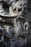 La piedra talla el dragón Imagenes de archivo