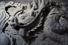 La piedra talla el dragón Foto de archivo