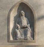 La pierre découpée antique de caractères chinois Images stock