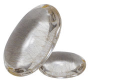 La pierre en cristal avec de l'argent et le bronze filète l'intérieur d'isolement sur W Images libres de droits