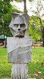 La pierre a fait face à l'homme en parc de Saigon photo libre de droits