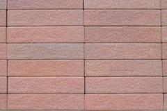 La pietra arancio o rossa blocca la parete Immagini Stock