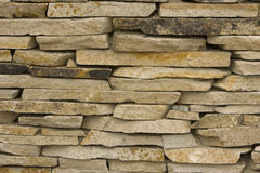 La pietra color crema dell'ardesia ha impilato Fotografie Stock