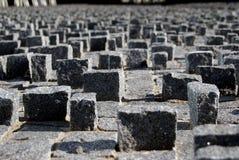 La pietra cuba il fondo sulla pavimentazione immagini stock libere da diritti