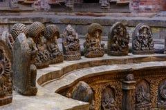 la pietra ha elaborato i dei in Lalitpur Nepal Fotografie Stock Libere da Diritti