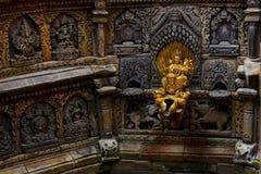 la pietra ha elaborato i dei in Lalitpur Nepal Fotografie Stock
