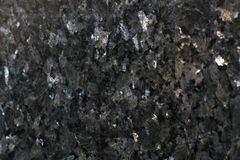 La pietra naturale, granito lucidato è chiamata Emerald Pearl Immagini Stock